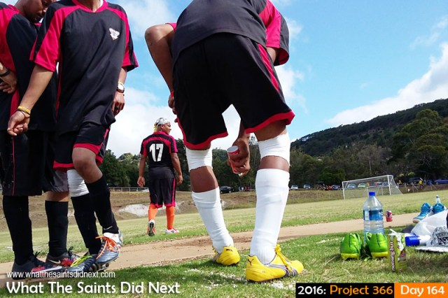 'Orlando Pulse' 12 June 2016, 14:37 - 1/760, f/2.4, ISO-50 - Samsung Galaxy A3 What The Saints Did Next - 2016 Project 366 Refugees football player applying muscle heat spray to sore joints at half time on Francis Plain, St Helena.