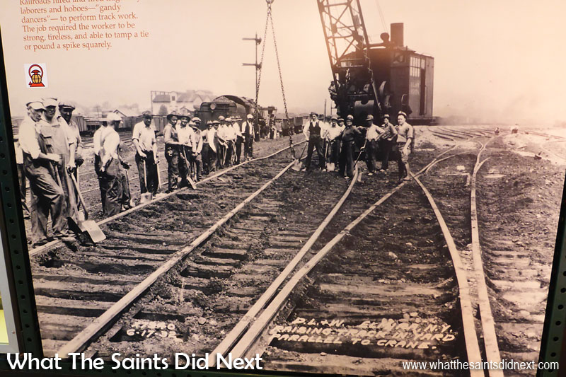 """""""Track workers were required to be strong, tireless, and be able to tamp a tie or pound a spike squarely. Photo dated: 6-17-32."""" Text written on picture reads: """"Raising track in yard parallel to crane.""""  The Steamtown Railroad Museum, Scranton, PA."""