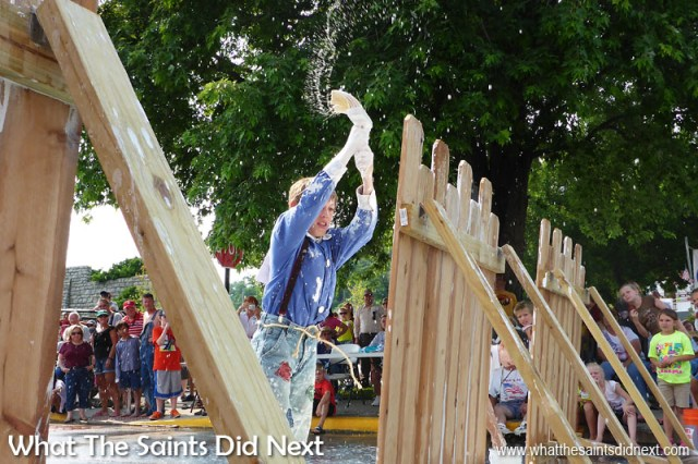 Fence painting in the annual, July Fourth, 'Tom Sawyer Day' competition is a very messy affair - don't stand too close! Hannibal, Missouri, on the banks of the Mississippi River is the boyhood home of American writer, Mark Twain, and this fun competition based on an event in his Tom Sawyer books, has become a famous tradition for the town.