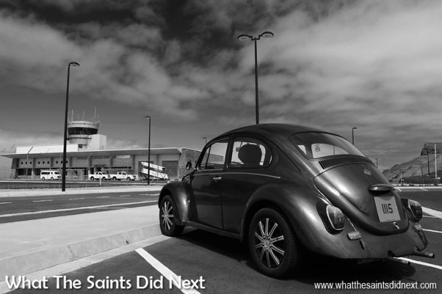 Black and White Photography Tips - Ideal conditions for black and white photography at the St Helena Airport. Repeat patterns of the car park lines, a deep blue sky with plenty of cloud textures, midday sunlight throwing sharp shadows and the beautiful curves of this VW Beetle. The trick with black & white photography is to recognise the conditions in colour (which is how our eyes we see the world) which translate well when colour is removed.