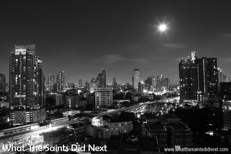 Black and White Photography Tips - A night time cityscape of Bangkok, in Thailand. The intricate patterns of shadow and light makes this cityscape work well in black and white.