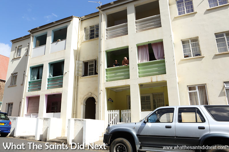 Residents at Old Boys' School apartments in upper Jamestown watching the morning street activity. The 2016 census revealed 629 of St Helena's 4,534 population live in Jamestown.