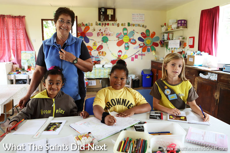 St Helena Brownies, Shantelle Youde, Holly Rose Crowie and Emily Brough working on their challenge in the Longwood Guide Hall (built in 2000) with Leader, Betty Joshua.