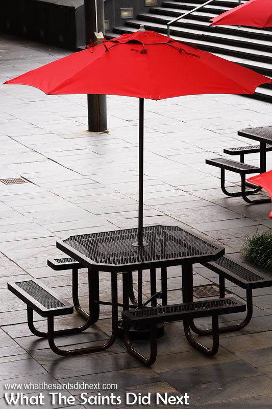 The neutral background colour here was just right to frame the red parasol against. The patterns in the paving tiles and table tops as well as the lines and shapes all contribute to give the shot an interesting texture. Colour photography tips.