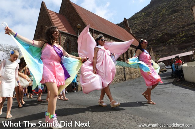 Miss St Helena 2016, Kimley Yon (centre) taking part in the carnival with first and second runners up, Kaylee Young and Jodie Scipio-Constantine. Carnival 2016 through historic Jamestown, St Helena. This year's theme, 'Taking Flight' brought out wings of all shapes and sizes.