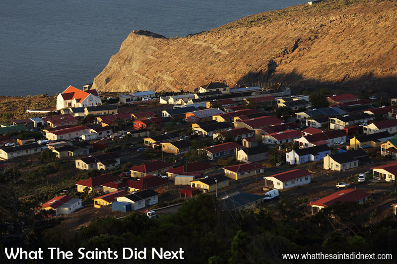 St Helena Pictures - An Island Tour Like matchboxes, Half Tree Hollow glows in the evening sunset, photographed from the top of High Knoll. In the distance the hillside fences above Jamestown are visible, as is the Mundens lookout station.