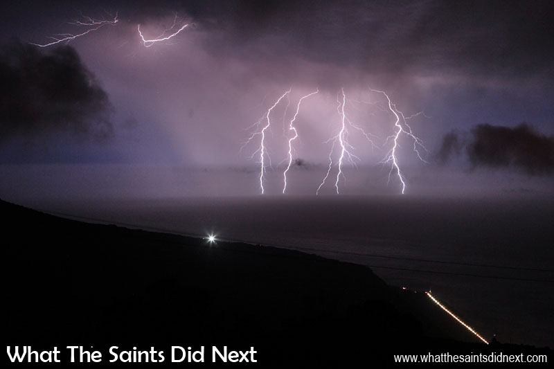 Fantastic display of lightning off the coast of St Helena Island. Taken from Alarm Forest; Jacob's Ladder (string of lights) to lower right, the single bright light on the ridge is in Half Tree Hollow. Picture captured with a 30sec exposure at 23:42 on 30 October, 2016. - Thunder and Lightning On St Helena