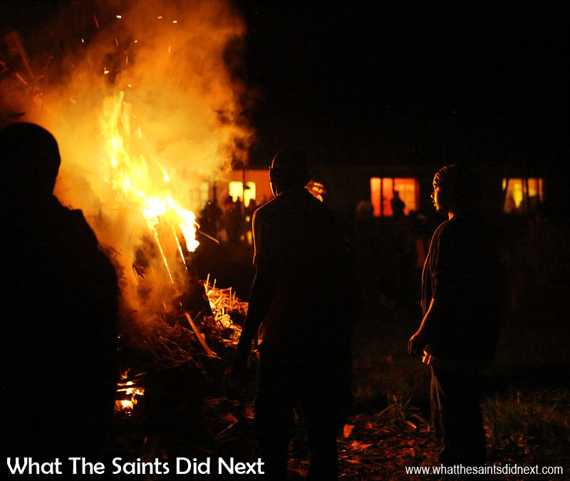 The 'fire lighters' stand back as the blaze begins to take hold.  Bonfire night in Sandy Bay, St Helena Island.