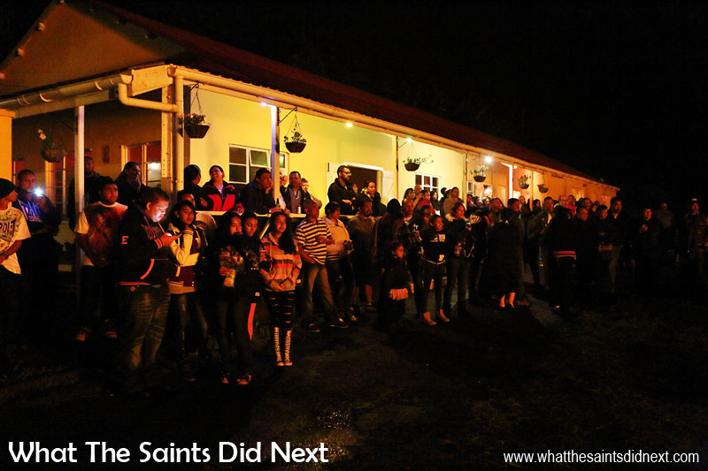 Caught in the fire glow - over 250 people from across the island came along to enjoy the traditional end to Guy Fawkes Day. Bonfire night in Sandy Bay, St Helena Island.