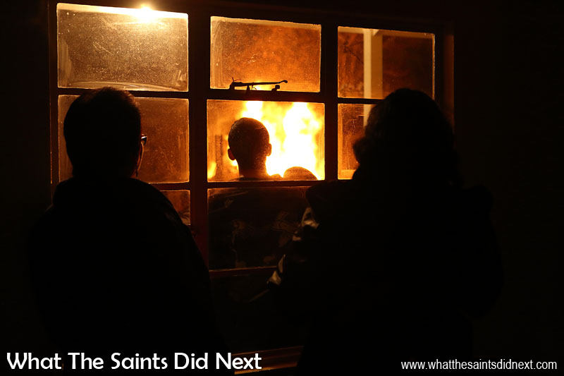 Through the window inside the Sandy Bay community centre.  Bonfire night in Sandy Bay, St Helena Island.