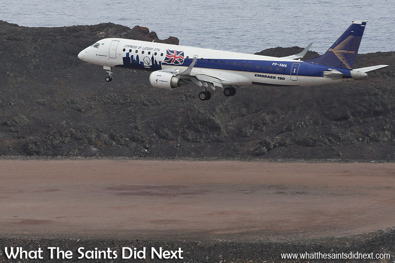 Embraer Trial Flight to St Helena. Embraer ERJ-190-100, over the Dry Gut fill at St Helena Airport, gliding smoothly to runway 02.