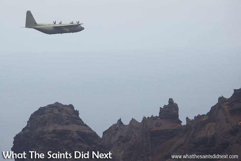 The RAF, Lockheed Martin C-130J Hercules flying over King and Queen Rock, at St Helena Airport.