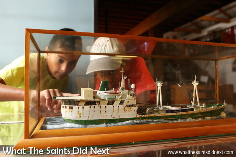 Things To Do With Kids On St Helena - Evan and Jacob checking out a model of the first RMS St Helena, one of the many fascinating things to see in the Museum of St Helena.