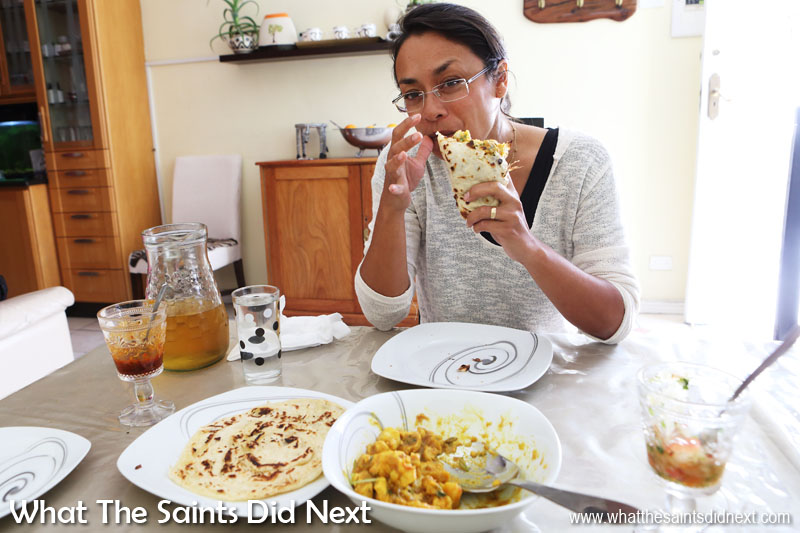 Sharon tucking into the meal with a chicken curry roti. Smiles says it all.