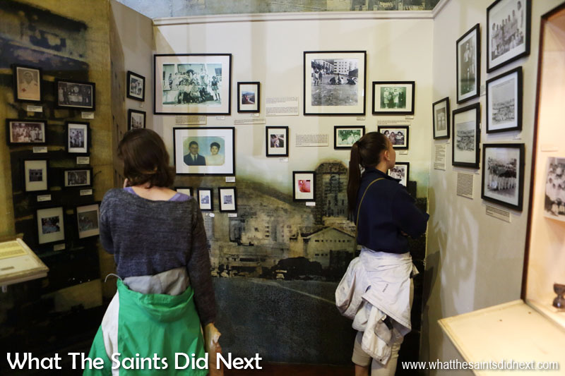 Visitors browsing inside the District Six Museum, Cape Town.