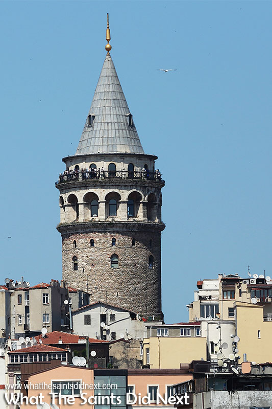The Galata Tower, Istanbul dominates the city's skyline, rising up above the hundreds of smaller buildings.