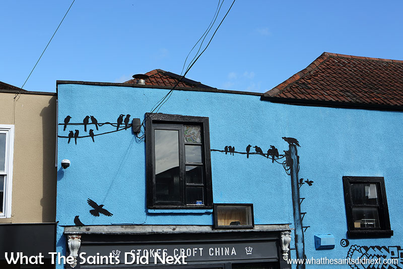 Cool graffiti art of birds on a wire, what's real and what's paint?
