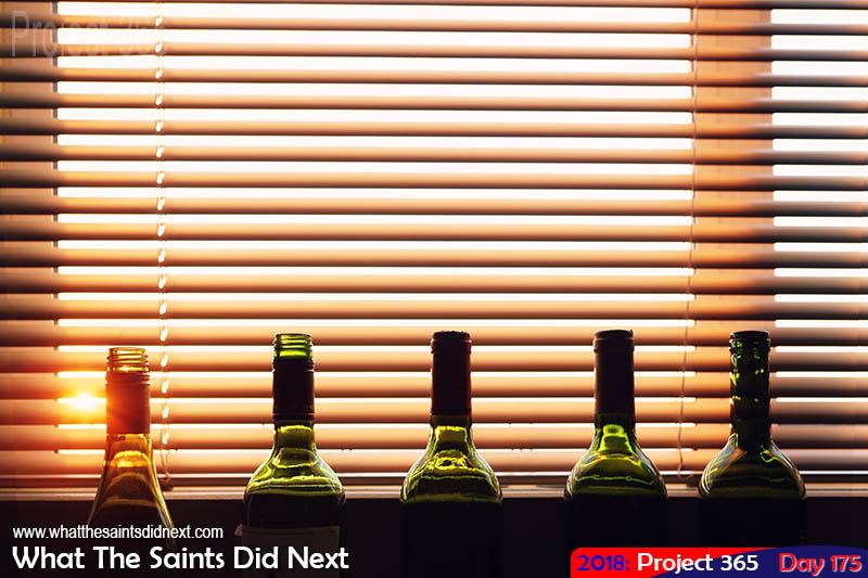 Empty wine bottles at sunset.