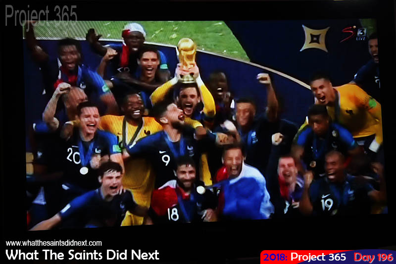 Live tv, France celebrating winning the FIFA World Cup in Russia, after beating Croatia in the final.