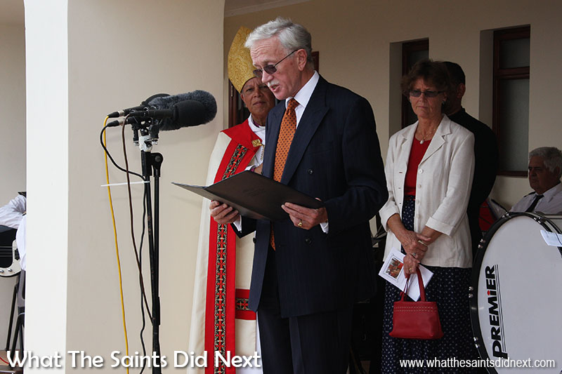 Governor Andrew Gurr giving a speech at the new St Helena care home opening ceremony, 6 September, 2008. Mrs Gurr standing behind him.