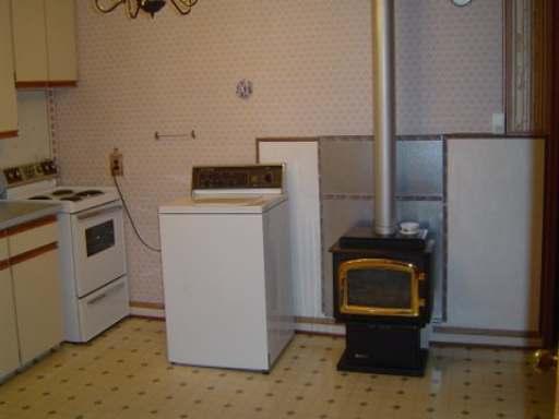 Spacious Kitchen... er...Laundry Room....er...Living Room