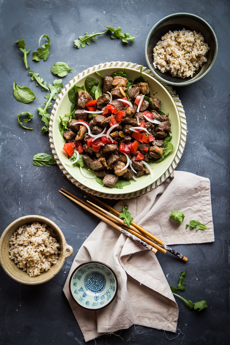 Vietnamese Shaking Beef with Garlic Sauce (Bo Luc Lac). Beef is seared in a wok and cook in a back and forth wok shaking action (hence the name) with garlic and seasoning and served over refreshing salad