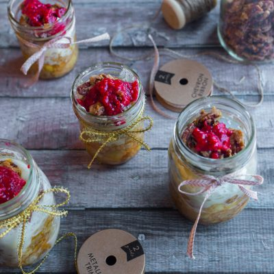 Apple pie with pecans and raspberry sauce in a jar