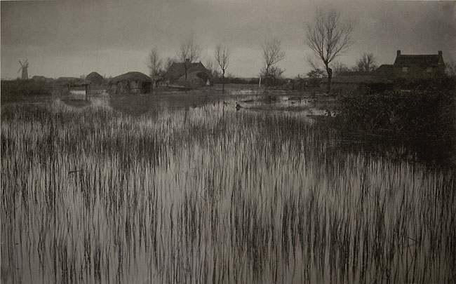 """A Rushy Shore, 1886"", platinum print by Peter Henry Emerson, featuring the ""broad atmospheric effect"" favored by Pictorialists (courtesy MFA, Boston)"