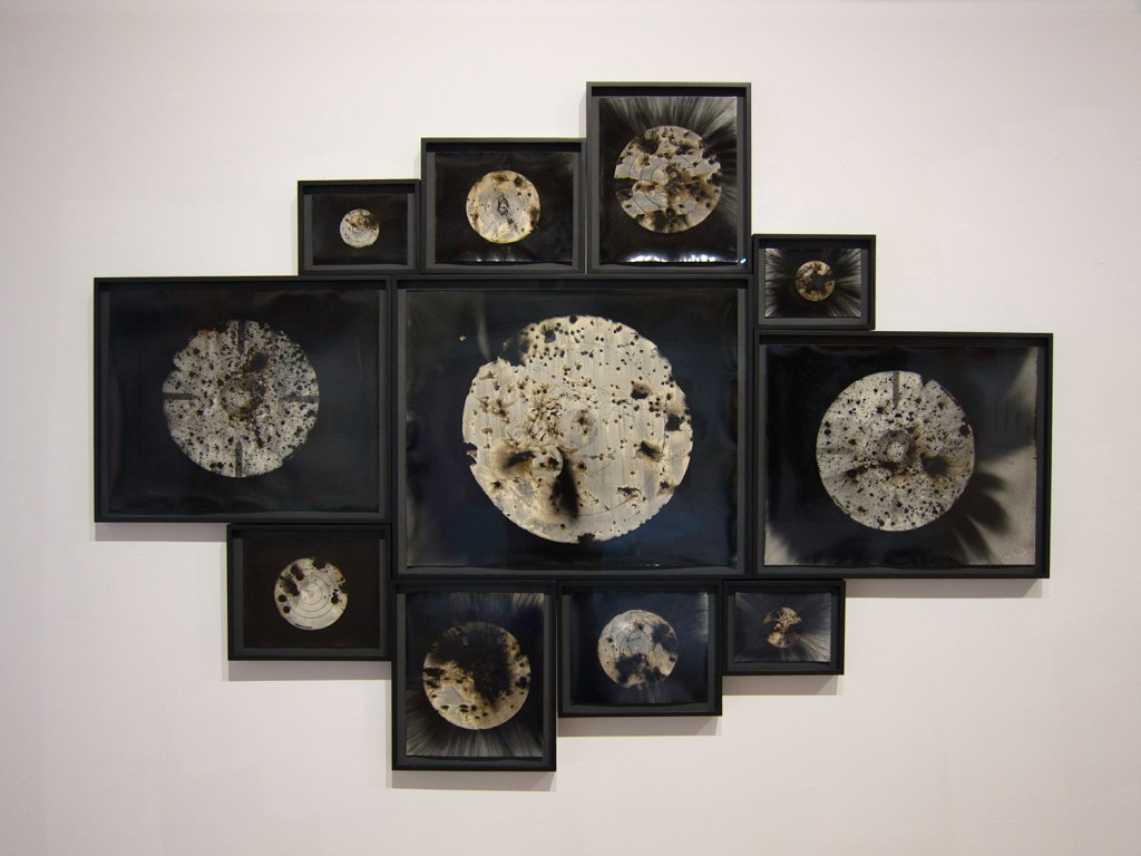 """Untitled Target Installation, 2015"", unique gunpowder generated gelatin silver prints from found targets by Christopher Colville (courtesy of the artist and Griffin Museum of Photography)."