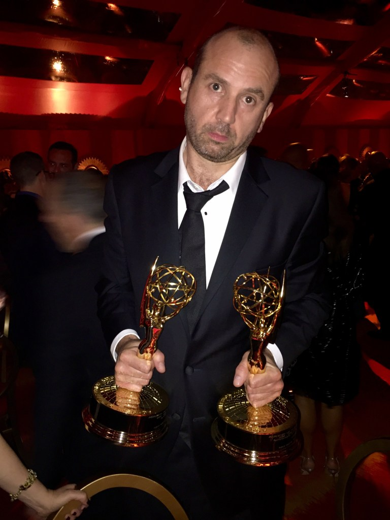 Tony Roche shows off his Emmy awards for Veep