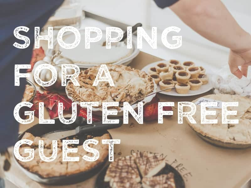 A buffet of pies and cookies, some gluten free, a silver pumpkin.