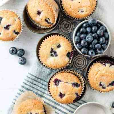 Gluten free blueberry muffins in a vintage muffin tin.