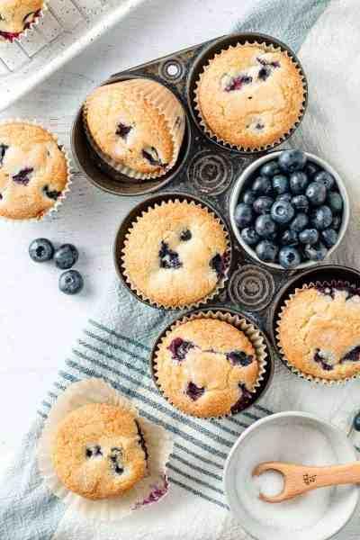Gluten free blueberry muffins in a vintage muffin tin.