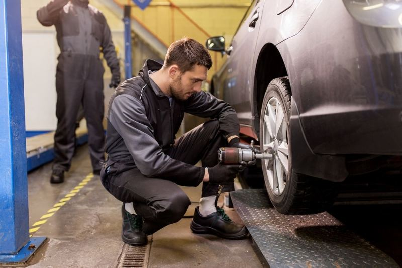 Tires Being Put On a Car