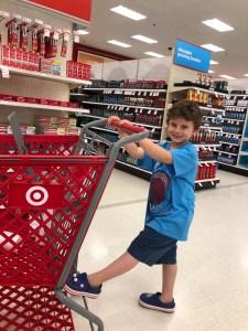 Boy behind Target shopping cart