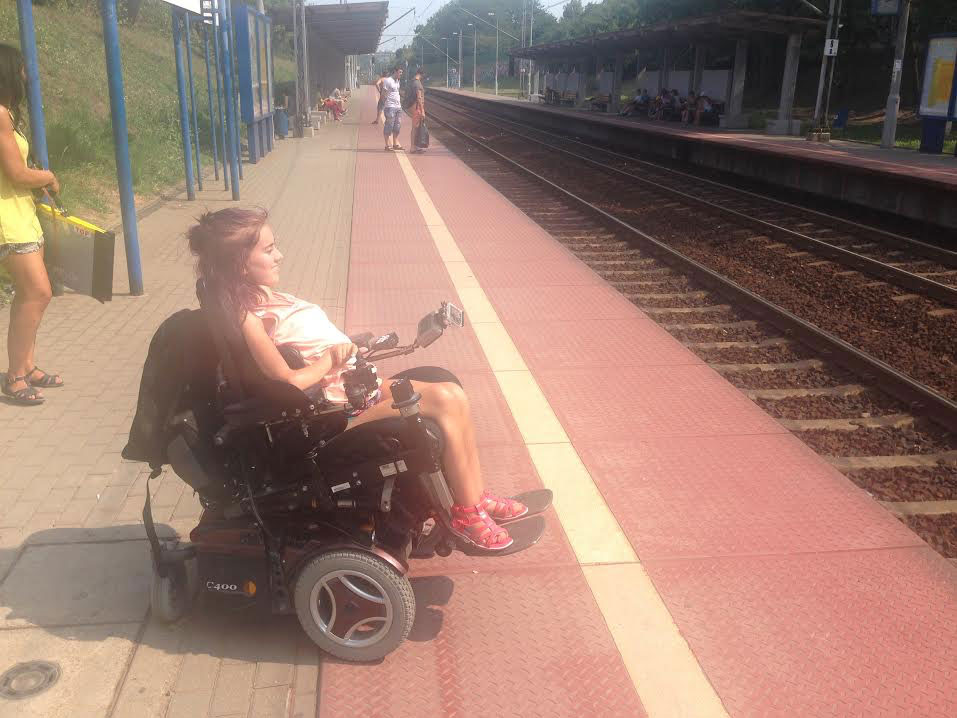 Tonje in her wheelchair at a train station in Warsaw, Poland