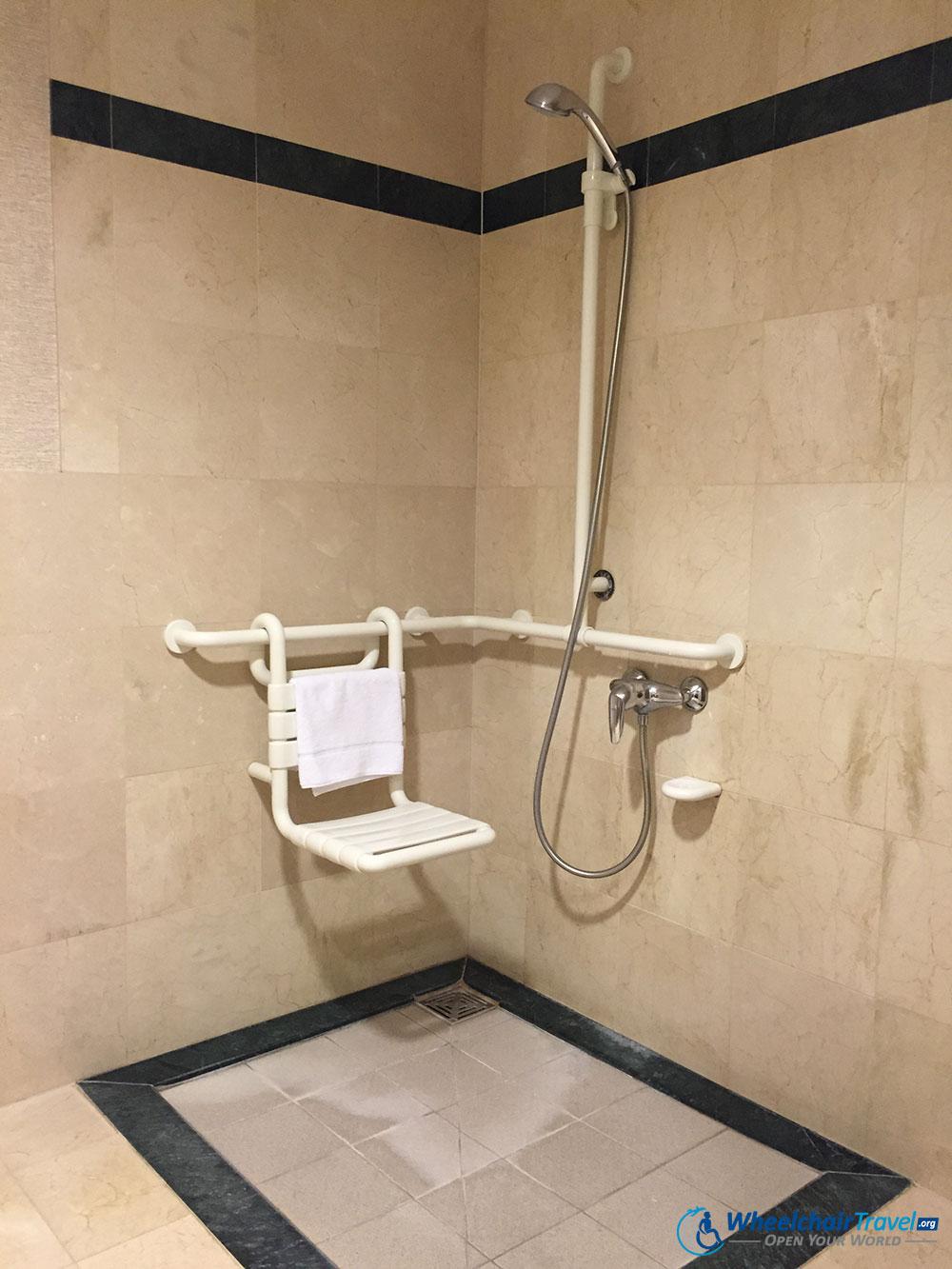 Brussels Marriott Roll-in Shower Wheelchair - WheelchairTravel.org