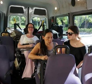 Kim Jago riding in a wheelchair accessible mini bus from California to Las Vegas