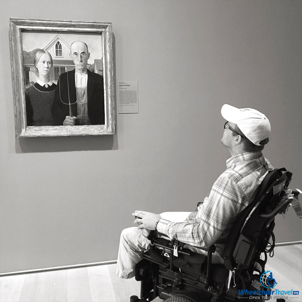 PHOTO: Wheelchair user John viewing Grant Wood's painting 'American Gothic' at the Art Institute of Chicago.