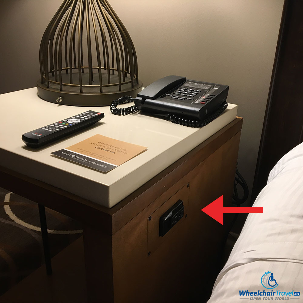 Bedside table/nightstand, with built-in power outlets.