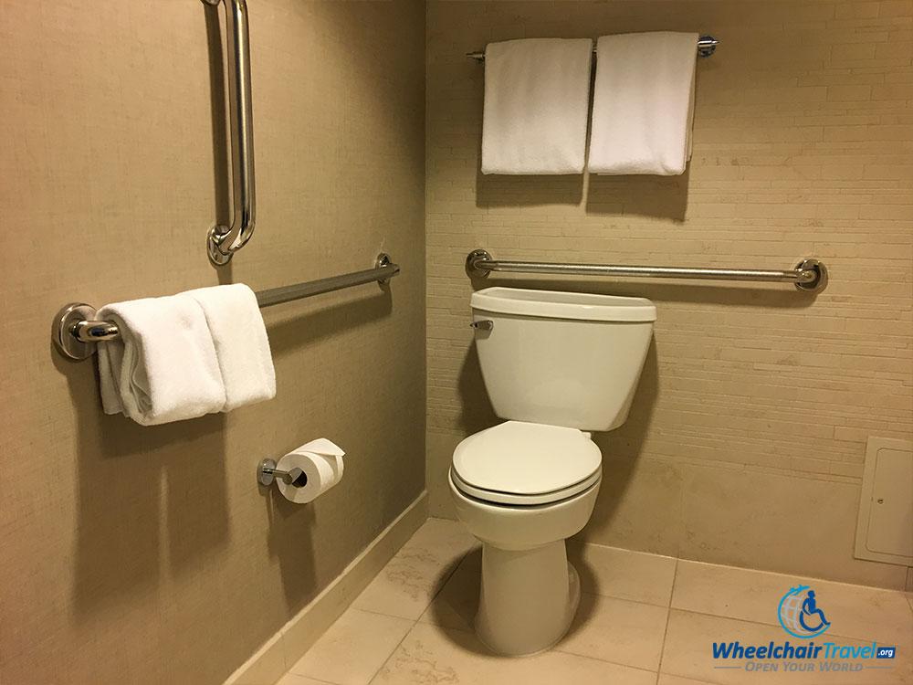 Bathroom toilet with grab bars at Hyatt Centric Arlington hotel