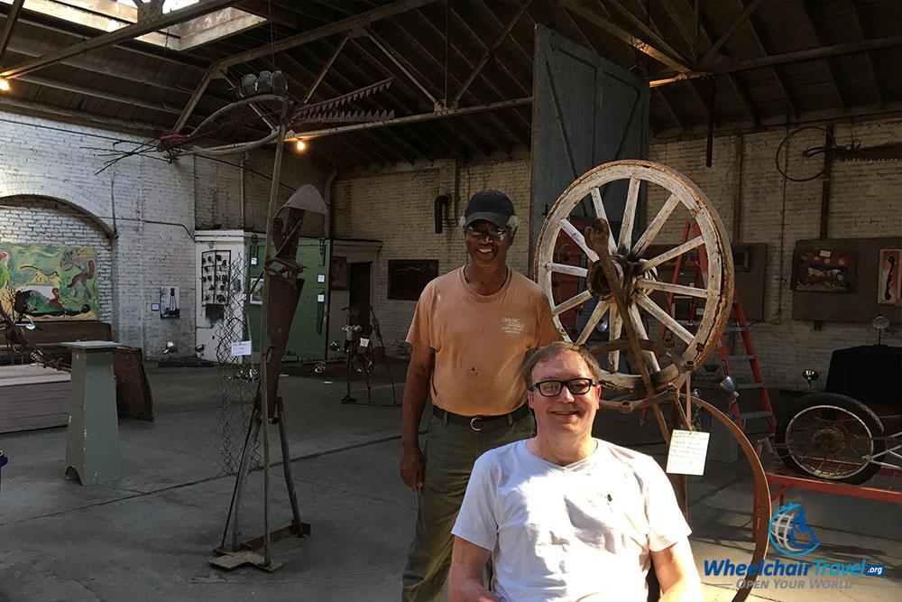 John Morris posing with Charlie Lucas, in the artist's Selma, Alabama gallery