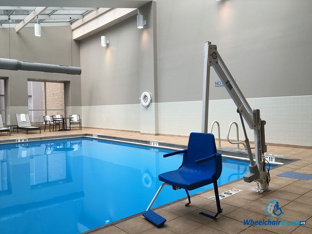 Swimming pool with self-operating lift.