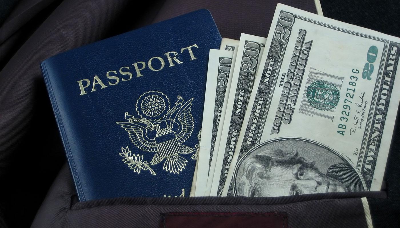Earn money for travel with the Acorns referral bonus.