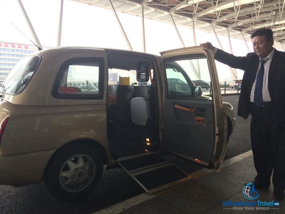 Wheelchair taxi and driver in Shanghai, China.