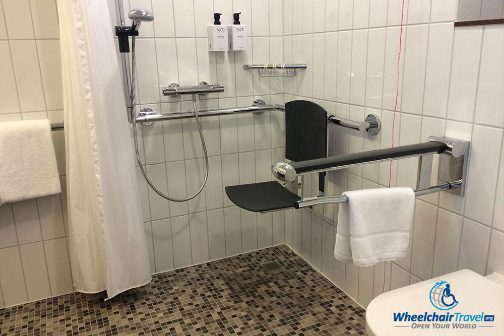 Roll-in shower at Scandic Berlin Potsdamer Platz hotel.