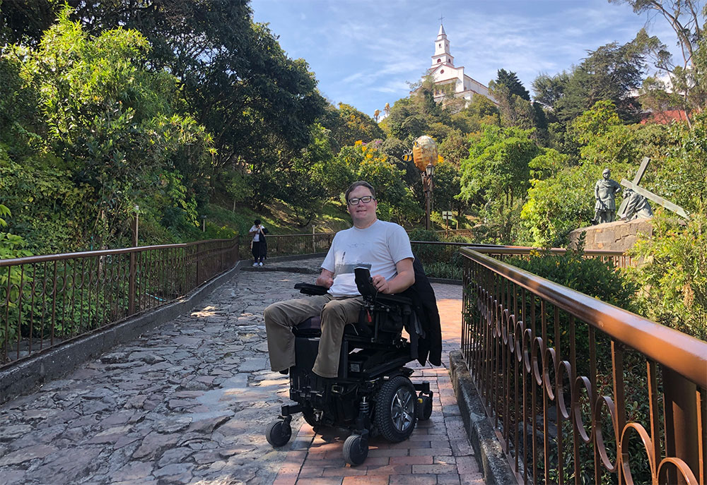 Posing for a photo on the wheelchair accessible path up Monserrate.