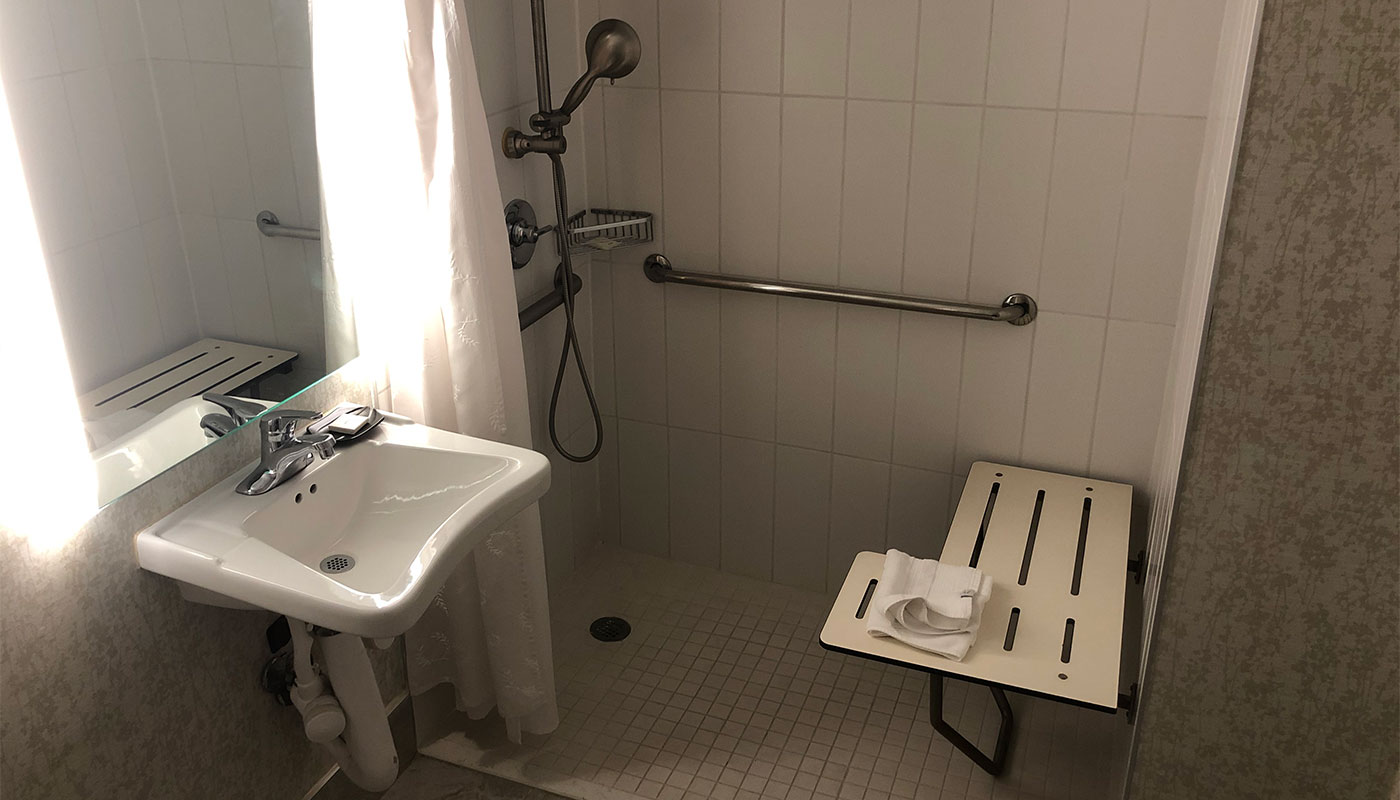 Roll-in shower at a hotel.