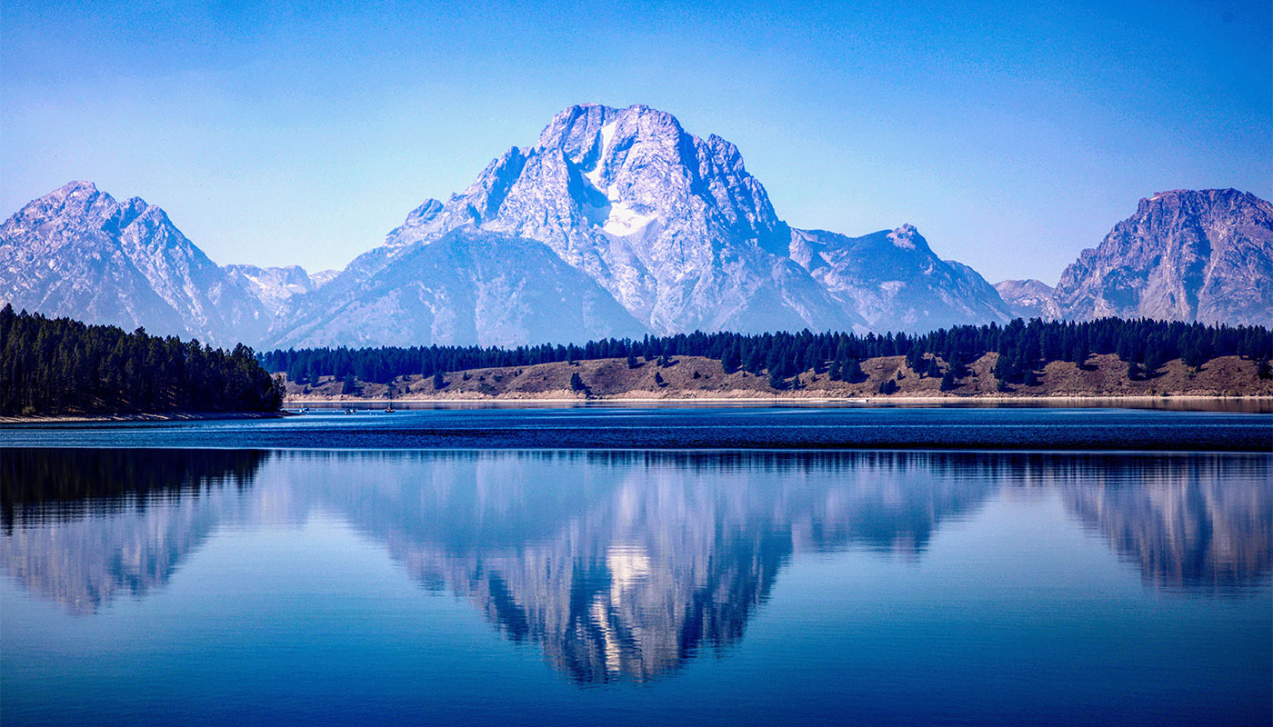 Mountain reflected in lake at a national park.
