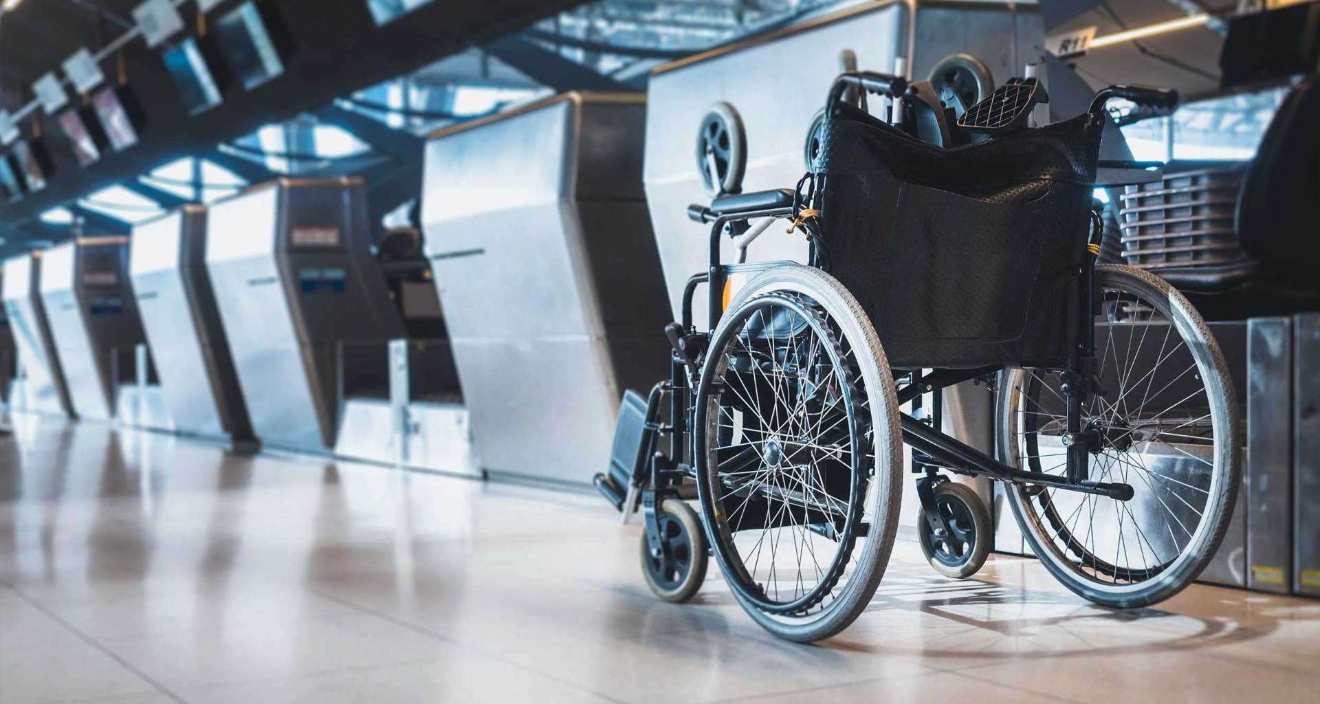Manual wheelchair at airport check-in counter.